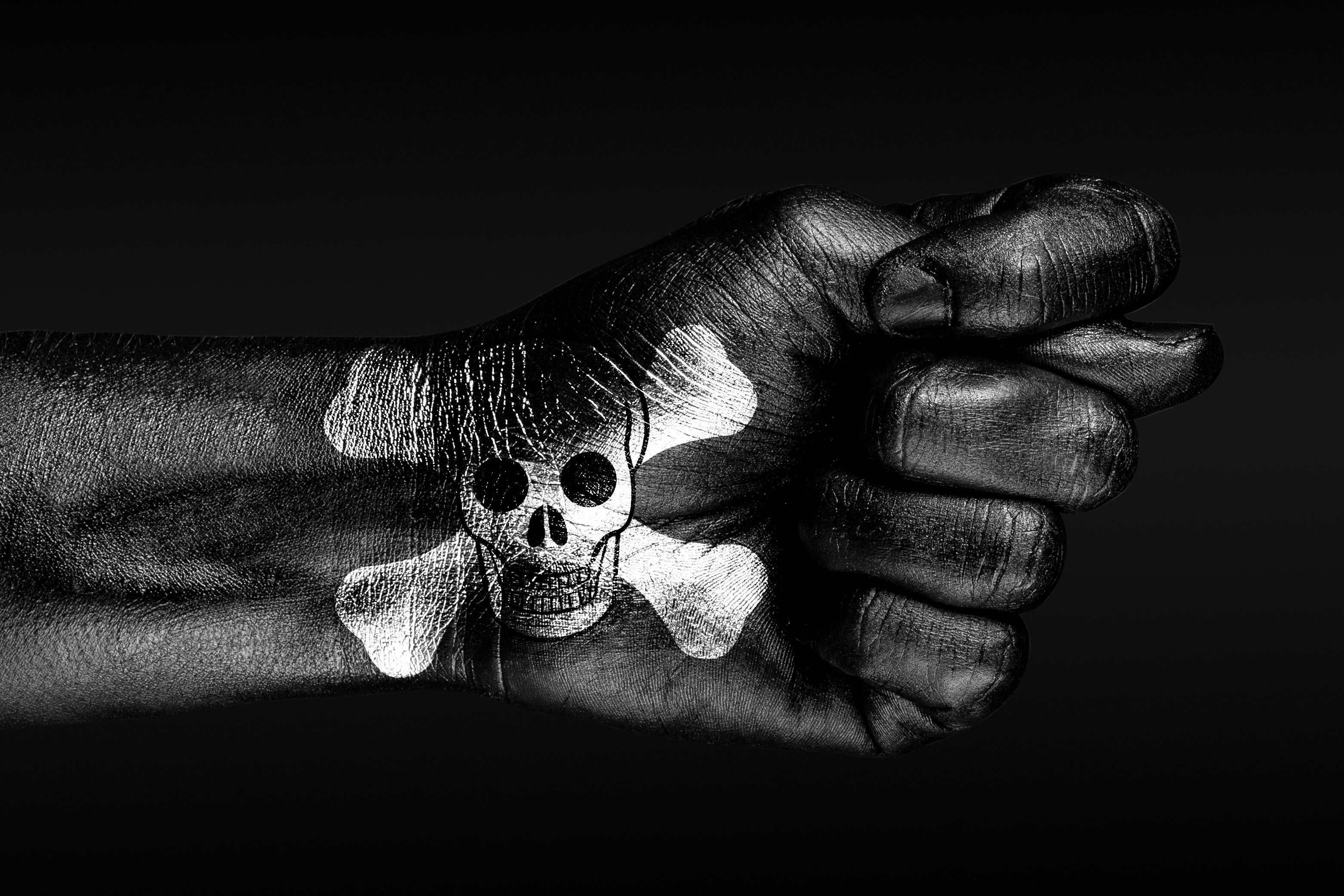 Hand with pirate skull