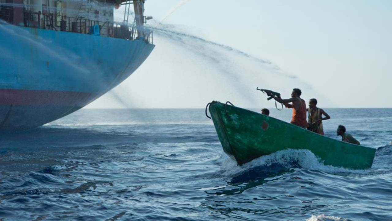 Somalian Pirates with weapons repelled by fire hoses